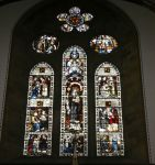Window st St HIlda's RC showing the life of St Hilda